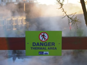 Signs warn people of the dangers of the hot water pools